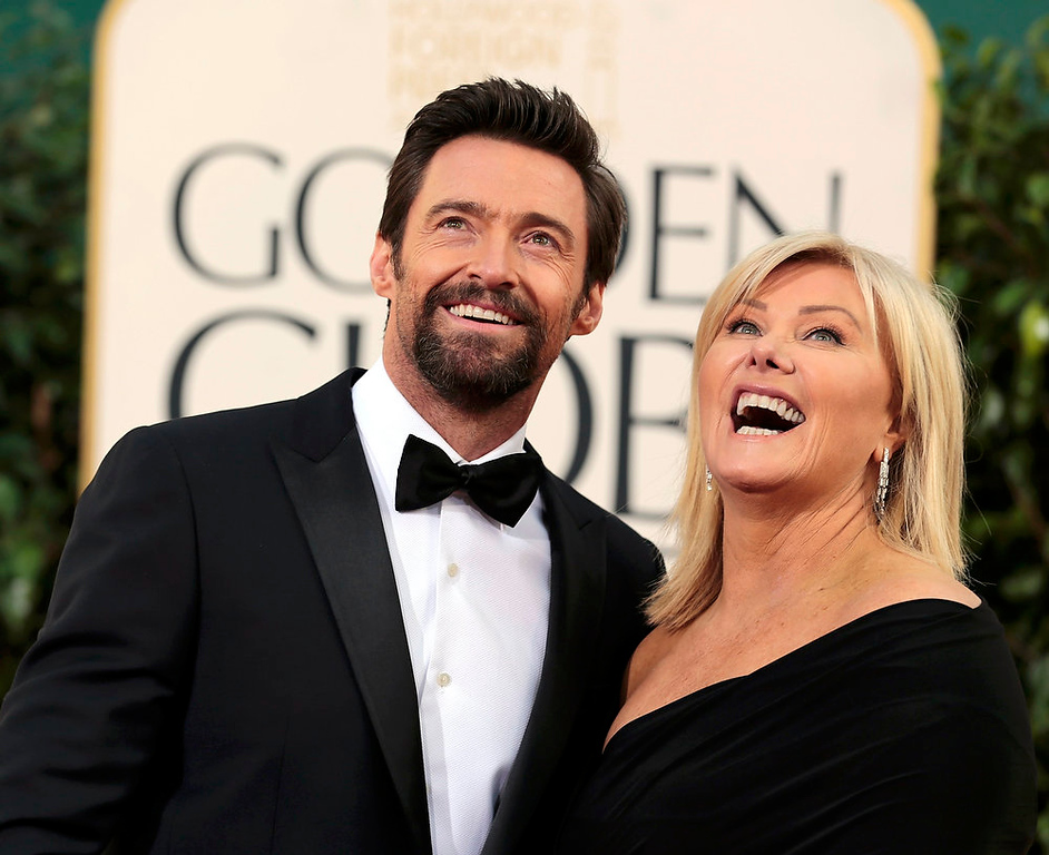 ". Actor Hugh Jackman of the film ""Les Miserables\"" and his wife Deborra-Lee Furness at the 70th annual Golden Globe Awards in Beverly Hills, California January 13, 2013. REUTERS/Jason Redmond"