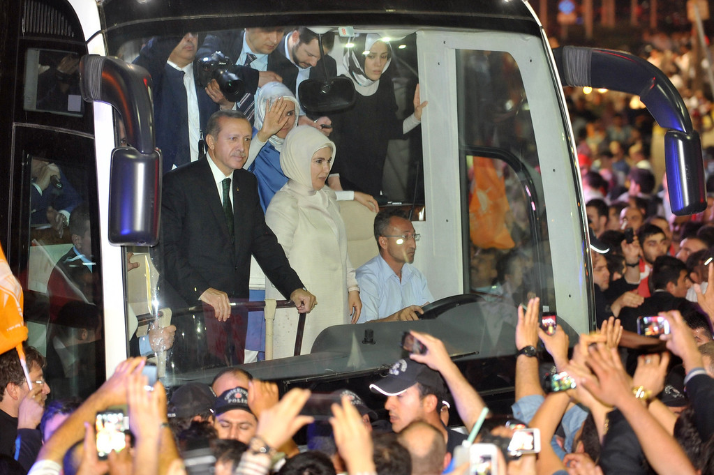 ". Turkish Prime Minister Recep Tayyip Erdogan  (L) is greeted by supporters upon arrival at Ataturk International Airport in Istanbul on June 7, 2013.Turkey\'s Islamic-rooted government apologised to wounded protestors and said it had ""learnt its lesson\"" after days of mass street demonstrations that have posed the biggest challenge to Prime Minister Recep Tayyip Erdogan\'s decade in office. Turkish police had on June 1 begun pulling out of Istanbul\'s iconic Taksim Square, after a second day of violent clashes between protesters and police over a controversial development project. What started as an outcry against a local development project has snowballed into widespread anger against what critics say is the government\'s increasingly conservative and authoritarian agenda.  OZAN KOSE/AFP/Getty Images"