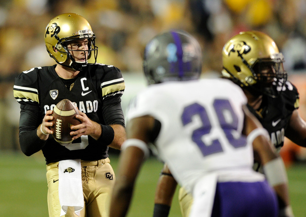 . BOULDER, CO. - SEPTEMBER 76: CU quarterback Connor Wood looked for open receivers in the second half. The University of Colorado football team hosted Central Arkansas at Folsom Field Saturday night, September 7, 2013. Photo By Karl Gehring/The Denver Post