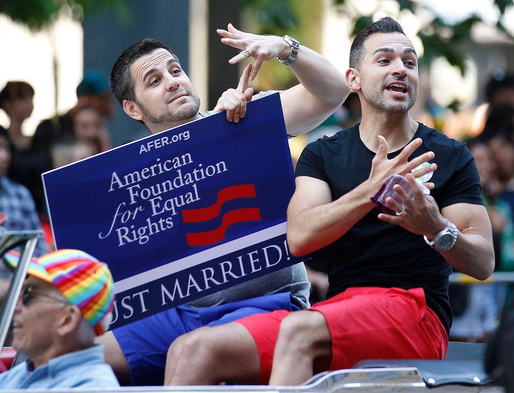 . Proposition 8 plaintiffs Paul Katami (R) and Jeff Zarrillo participate in the San Francisco Gay Pride Parade in San Francisco, California, June 30, 2013. REUTERS/Jed Jacobsohn