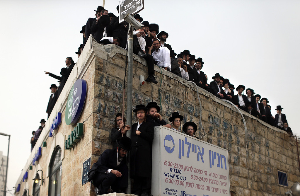 . Hundreds of thousands of Ultra Orthodox Jews gather on March 2, 2014, in Jerusalem to demonstrate against any plans to make them undergo military service. The protests were sparked by cuts in government funding to Jewish theological seminaries, or yeshivas, and a planned crackdown on young ultra-Orthodox men seeking to avoid Israel\'s compulsory military draft.  THOMAS COEX/AFP/Getty Images