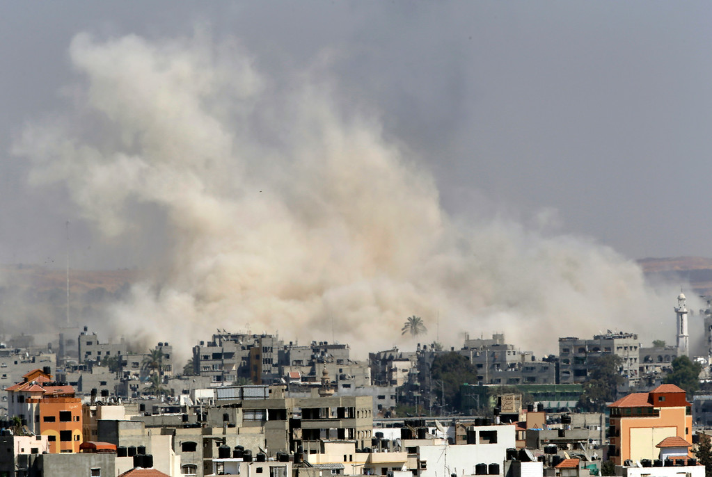 . Smoke rises from an Israeli strike in Gaza City, Tuesday, July 29, 2014. Israel struck symbols of Hamas\' control of Gaza and the strip\'s only power plant on Tuesday, escalating its military campaign against the Islamic militant group with the heaviest bombardment in the fighting so far. (AP Photo/Lefteris Pitarakis)