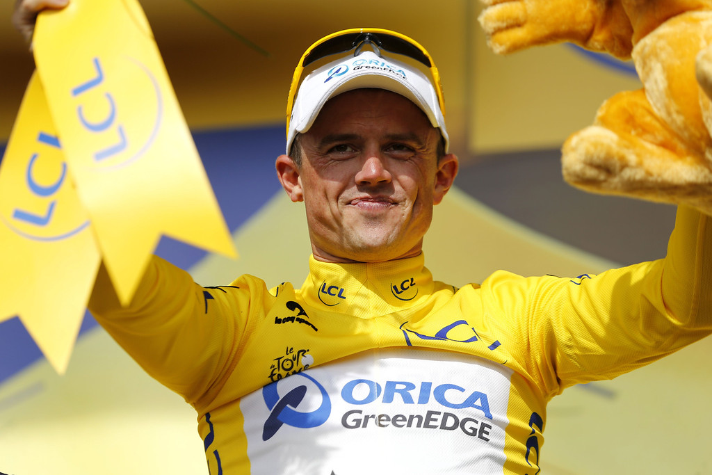 . Australia\'s Simon Gerrans celebrates his yellow jersey of overall leader on the podium at the end of the 228.5 km fifth stage of the 100th edition of the Tour de France cycling race on July 3, 2013 between Cagnes-sur-Mer and Marseille, southern France.  AFP PHOTO / PASCAL  GUYOT/AFP/Getty Images
