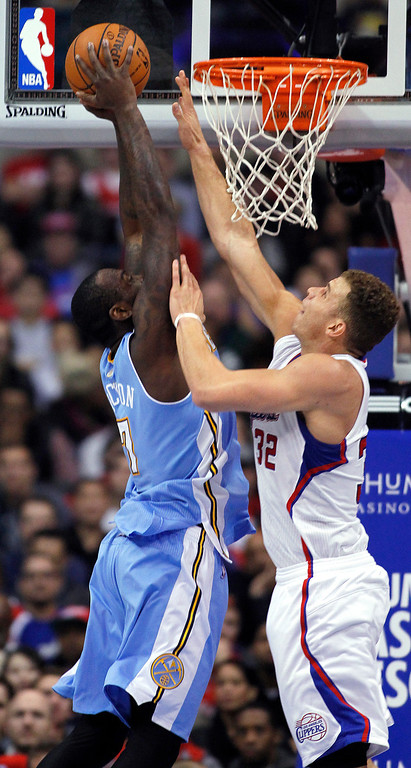. Denver Nuggets forward J.J. Hickson, left, goes up to the basket with Los Angeles Clippers forward Blake Griffin (32) defending during the first half of an NBA basketball game in Los Angeles on Saturday, Dec. 21, 2013. (AP Photo/Alex Gallardo)