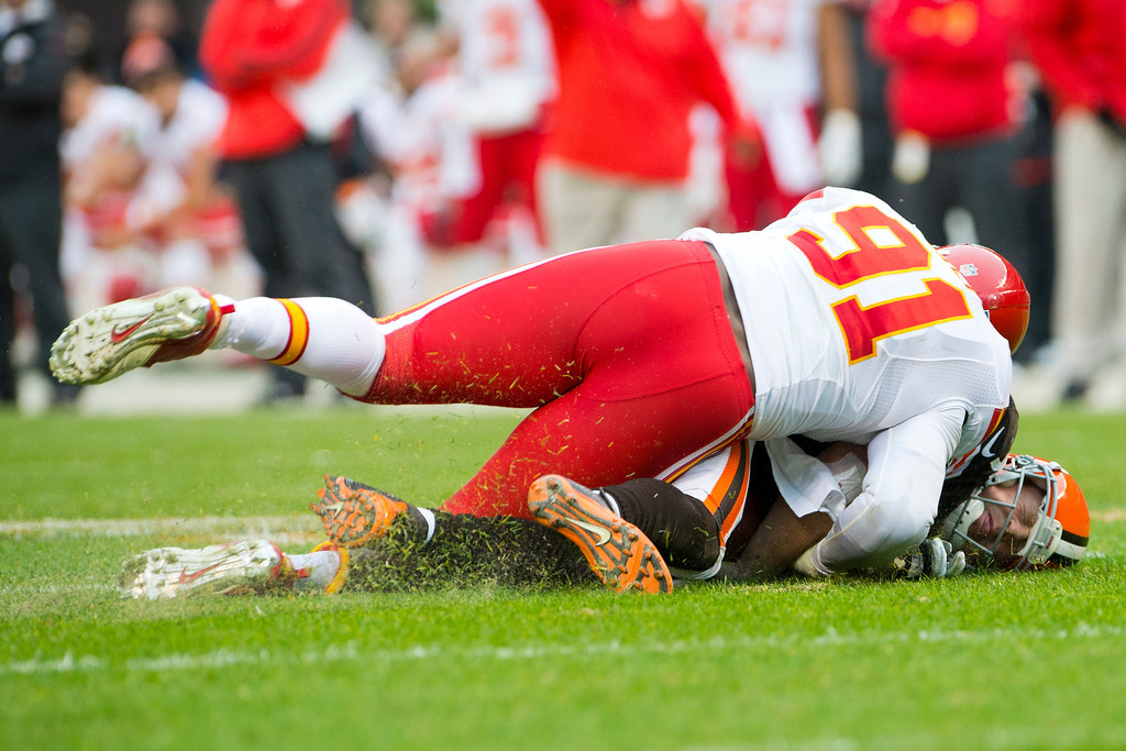 . CLEVELAND, OH - DECEMBER 09: Outside linebacker Tamba Hali #91 of the Kansas City Chiefs sacks quarterback Brandon Weeden #3 of the Cleveland Browns during the first half at Cleveland Browns Stadium on December 9, 2012 in Cleveland, Ohio. (Photo by Jason Miller/Getty Images)