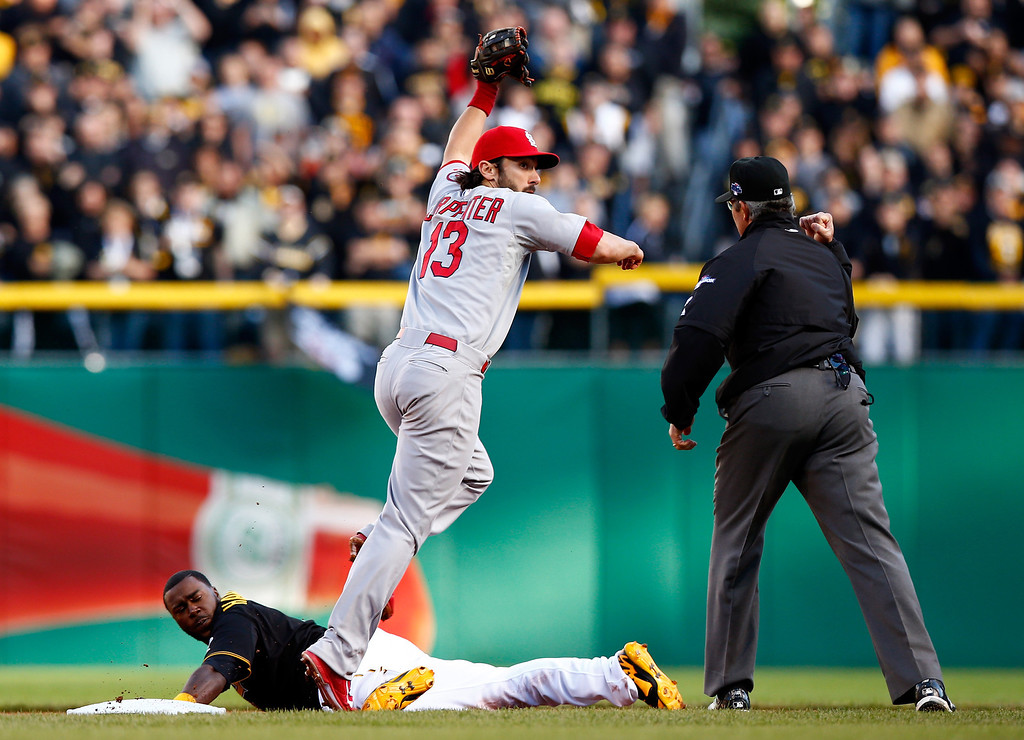. Matt Carpenter #13 of the St. Louis Cardinals tags out Josh Harrison #5 of the Pittsburgh Pirates at second base at an attempted steal in the eighth inning during Game Four of the National League Division Series at PNC Park on October 7, 2013 in Pittsburgh, Pennsylvania.  (Photo by Jared Wickerham/Getty Images)