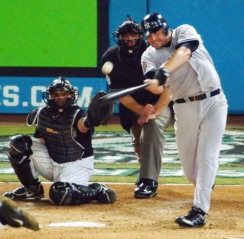 . ROGER CLEMENS -- New York Yankees pitcher Roger Clemens singles with his first World Series hit in the fifth inning of game 4 of the World Series at Pro Player Stadium in Miami, Fla., on Oct. 22, 2003. (AP Photo/Dave Martin)