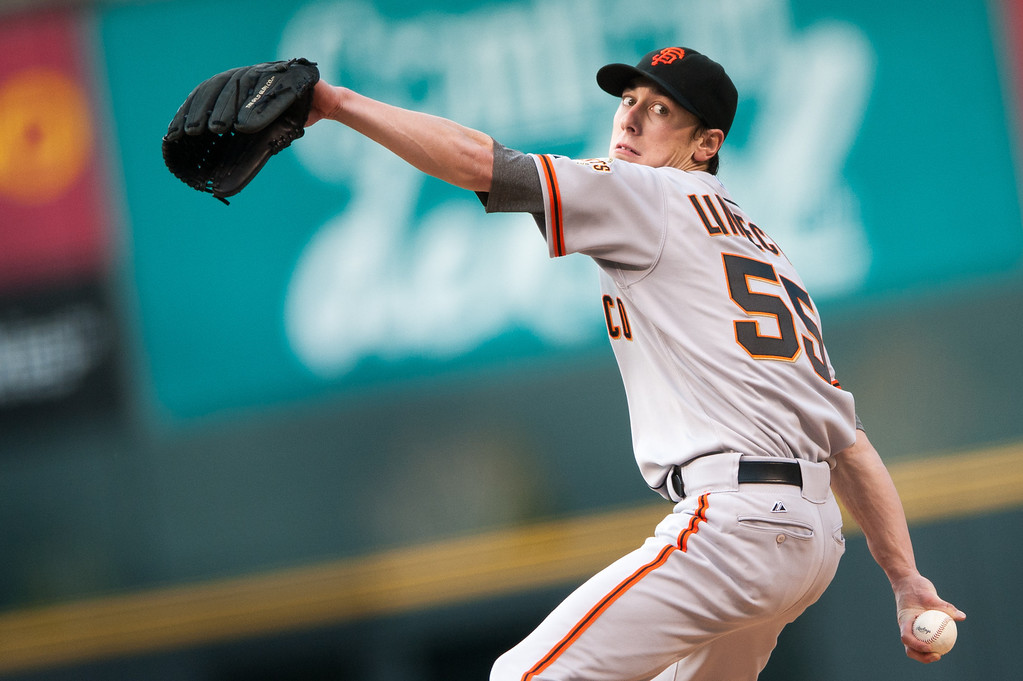 . DENVER, CO - MAY 18:  Tim Lincecum #55 of the San Francisco Giants delivers a pitch against the Colorado Rockies in the first inning of a game at Coors Field on May 18, 2013 in Denver, Colorado.  (Photo by Dustin Bradford/Getty Images)