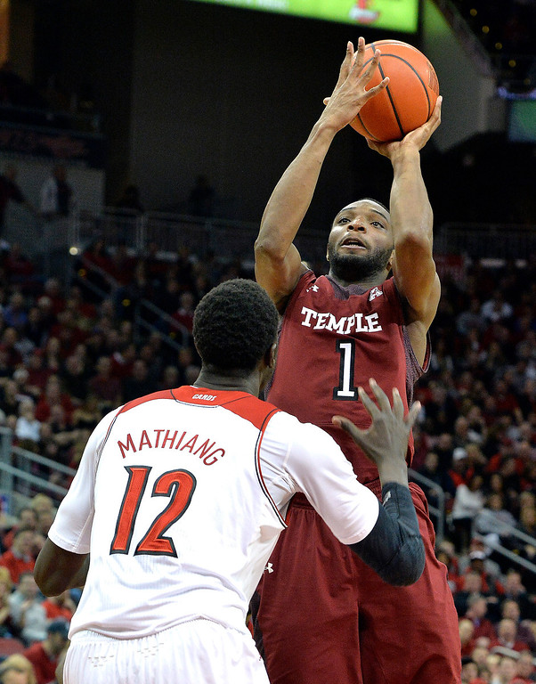 . Temple\'s Josh Brown shoots over Louisville\'s Mangok Mathiang during the first half of an NCAA college basketball game, Thursday, Feb. 27, 2014, in Louisville, Ky. (AP Photo/Timothy D. Easley)