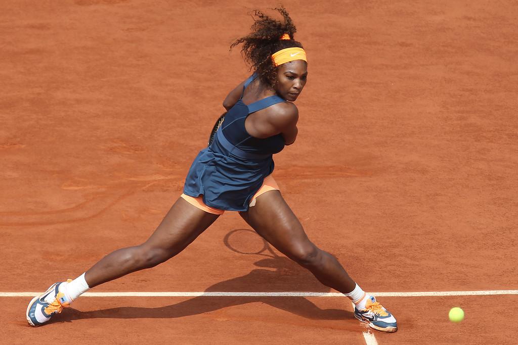 . Serena Williams of the U.S. returns against Russia\'s Maria Sharapova in the women\'s final of the French Open tennis tournament, at Roland Garros stadium in Paris, Saturday June 8, 2013. (AP Photo/David Vincent)