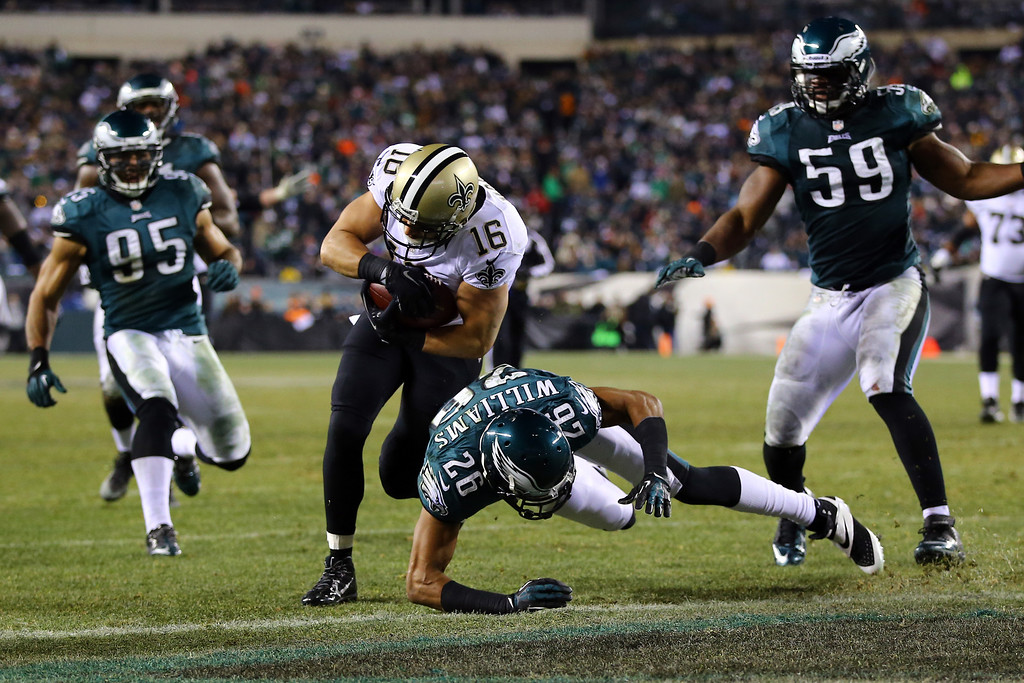 . PHILADELPHIA, PA - JANUARY 04:  Lance Moore #16 of the New Orleans Saints scores a 24 yard touchdown thrown by  Drew Brees #9 in the third quarter Cary Williams #26 of the Philadelphia Eagles during their NFC Wild Card Playoff game at Lincoln Financial Field on January 4, 2014 in Philadelphia, Pennsylvania.  (Photo by Al Bello/Getty Images)