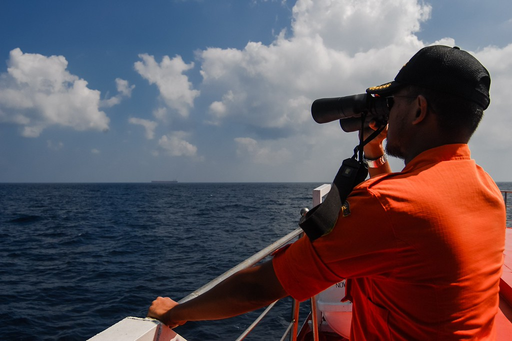 . An Indonesian National Search and Rescue Agency personnel scans the seas aboard a boat on patrol in the Malacca Strait off Aceh province located in the area of northern Sumatra island on March 12, 2014 during the continued search for the missing Malaysia Airlines flight MH370. AFP PHOTO / CHAIDEER MAHYUDDIN/AFP/Getty Images