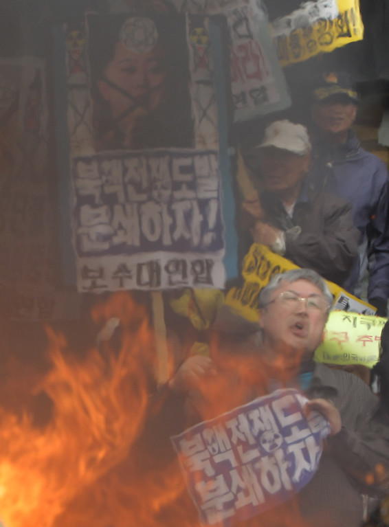 . SEOUL, SOUTH KOREA - APRIL 15:  South Korean conservative protesters burn a mockup of a North Korean missile and effigies of North Korea national founder Kim Il-Sung, former North Korean leader Kim Jong-Il and now leader Kim Jong-Un during an anti-North Korea rally on April 15, 2013 in Seoul, South Korea. North Korea marks its founder Kim Il-Sung\'s 101th birthday today while the fear on possible missile launch continues.  (Photo by Chung Sung-Jun/Getty Images)