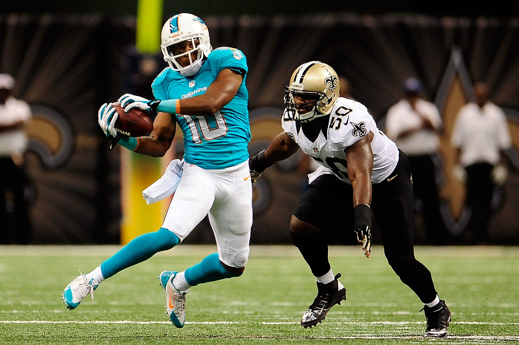 . Brandon Gibson #10 of the Miami Dolphins catches a pass in front of Curtis Lofton #50 of the New Orleans Saints during a game at the Mercedes-Benz Superdome on September 30, 2013 in New Orleans, Louisiana.  (Photo by Stacy Revere/Getty Images)