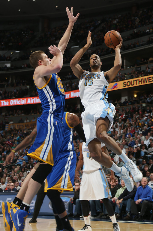 . Denver Nuggets forward Anthony Randolph, right, drives for a shot as Golden State Warriors forward David Lee covers during the third quarter of the Warriors\' 89-81 victory in an NBA basketball game in Denver on Monday, Dec. 23, 2013. (AP Photo/David Zalubowski)