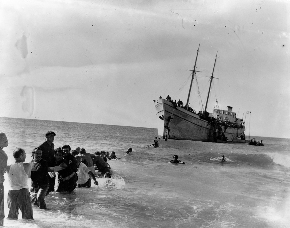 . Jewish refugees swim to shore from the SS \'United Nations\' (formerly the Archimedes) which deliberately ran agound at Nahariya near Haifa carrying 700 central European Jewish refugees. It sailed from Bari, Italy, evading vessels of the British blockade on the way.   (Photo by Keystone/Getty Images)