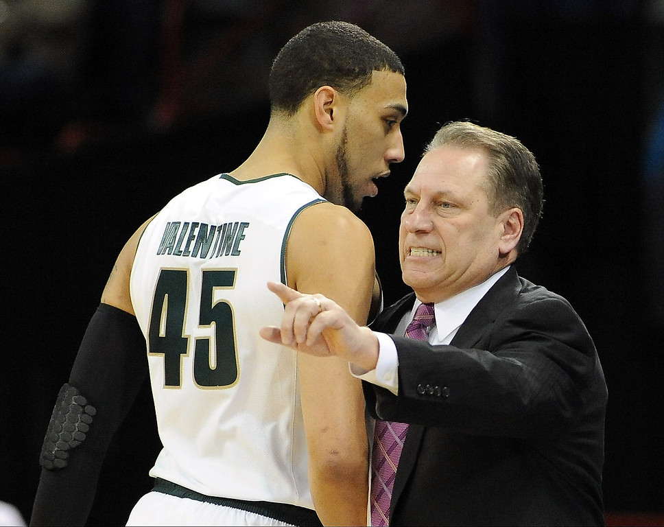 . Michigan State Spartans head coach Tom Izzo  talks to Denzel Valentine #45 during their game against the Delaware Fightin Blue Hens in the second round of the 2014 NCAA Men\'s Basketball Tournament at Spokane Veterans Memorial Arena on March 20, 2014 in Spokane, Washington.  (Photo by Steve Dykes/Getty Images)