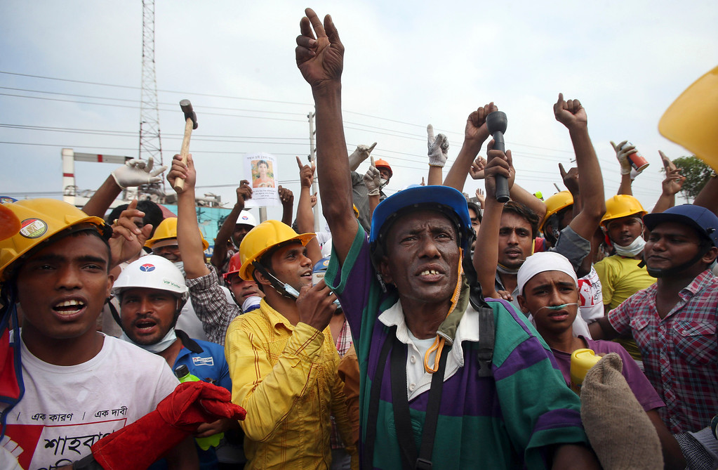 . In this photo taken on Sunday April 28, 2013, volunteer workers protest when they were told that the search would have to stop as they want to continue searching for victims believed to be alive and still trapped.(AP Photo/Wong Maye-E)