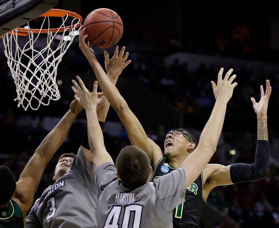 . Baylor\'s Isaiah Austin, right, reaches over Creighton\'s Doug McDermott (3) and Zach Hanson (40) for a rebound during the first half of a third-round game in the NCAA college basketball tournament Sunday, March 23, 2014, in San Antonio. (AP Photo/Eric Gay)