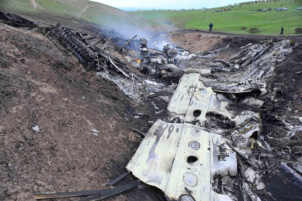 . The wreckage of the Boeing KC-135 Stratotanker plane is seen at the site of the crash near the Kyrgyz village of Chaldovar, May 3, 2013. REUTERS/Sabyr Alichiev/Pool