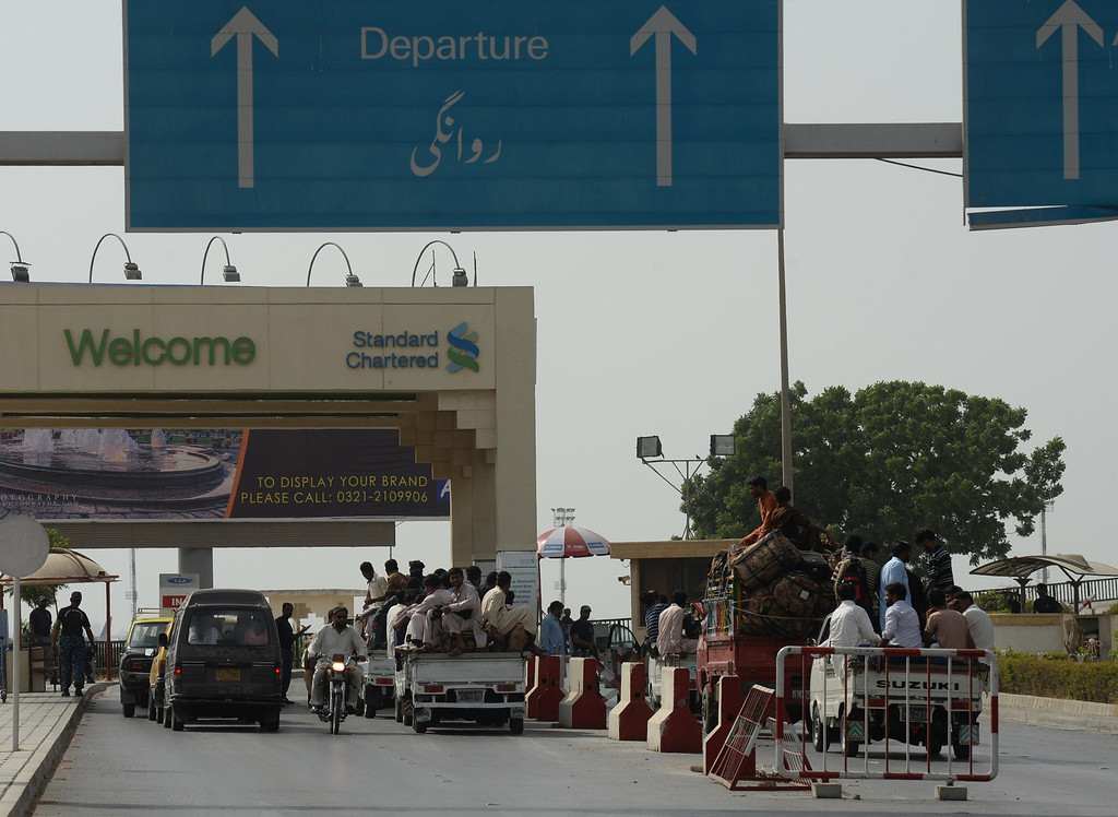 . Pakistani passengers arrive at Jinnah International Airport following an assault by militants on the airport in Karachi on June 9, 2014.  AFP PHOTO/Asif  HASSAN/AFP/Getty Images