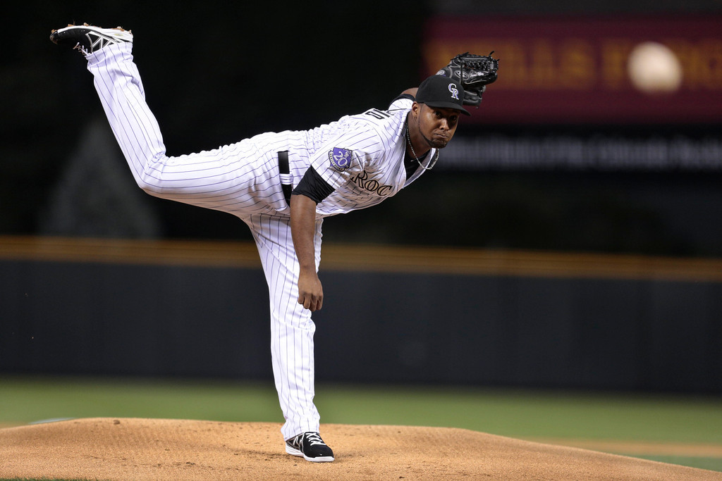 . Colorado Rockies starting pitcher Juan Nicasio delivers against the PIttsburgh Pirates in the first inning of a baseball game in Denver, Saturday, Aug. 10, 2013. (AP Photo/Joe Mahoney)