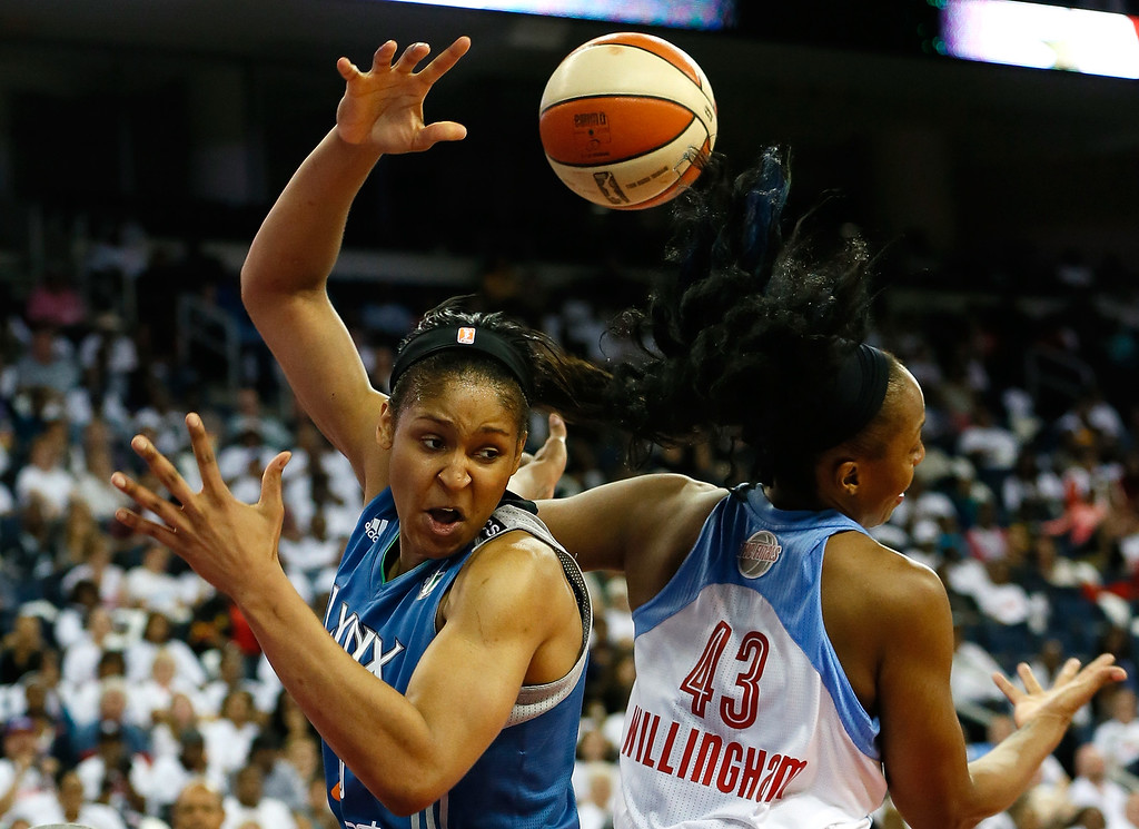 . ATLANTA, GA - OCTOBER 10:  Maya Moore #23 of the Minnesota Lynx battles for a rebound against Le\'coe Willingham #43 of the Atlanta Dream during Game Three of the 2013 WNBA Finals at Philips Arena on October 10, 2013 in Atlanta, Georgia.   (Photo by Kevin C. Cox/Getty Images)