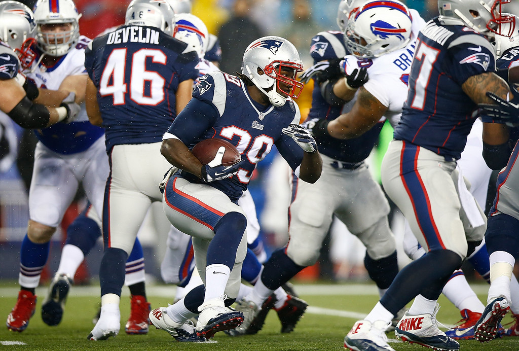 . LeGarette Blount #29 of the New England Patriots runs with the ball against the Buffalo Bills in the first quarter during the game at Gillette Stadium on December 29, 2013 in Foxboro, Massachusetts.  (Photo by Jared Wickerham/Getty Images)
