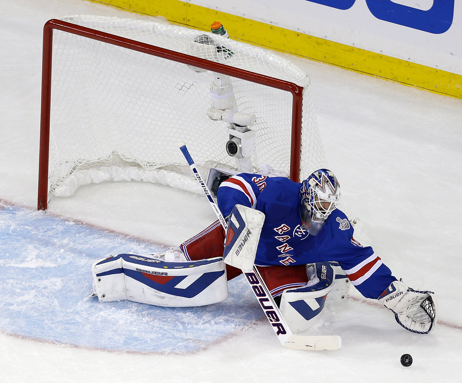 . New York Rangers goalie Henrik Lundqvist (30) makes a save in the first period during Game 4 of the NHL hockey Stanley Cup Final against the Los Angeles Kings, Wednesday, June 11, 2014, in New York. (AP Photo/Seth Wenig)