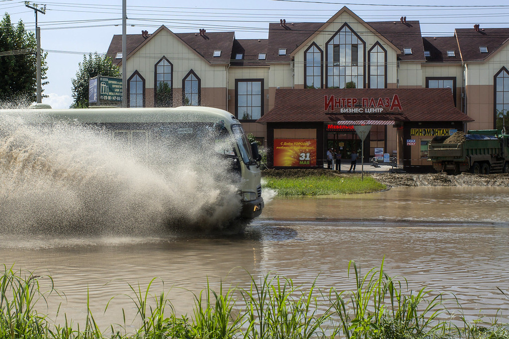 . A bus operates on a flooded street, on August 21, 2013 in Khabarovsk. Floods in the Russian Far East broke today historic records as authorities evacuated over 19,000 people from affected areas and warned of a further rise in water levels. Levels in the Amur river which flows from Russia to China broke historic records in the city of Khabarovsk and rain continued to batter the region as authorities sent out bottled water and administered shelters for displaced residents.   IGOR CHURAKOV/AFP/Getty Images