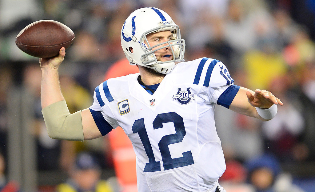 . epa04016071 Indianapolis Colts quarterback Andrew Luck passes against the New England Patriots in the second quarter of their AFC Divisional Playoff game at Gillette Stadium in Foxborough, Massachusetts, USA, 11 January 2014  EPA/CJ GUNTHER