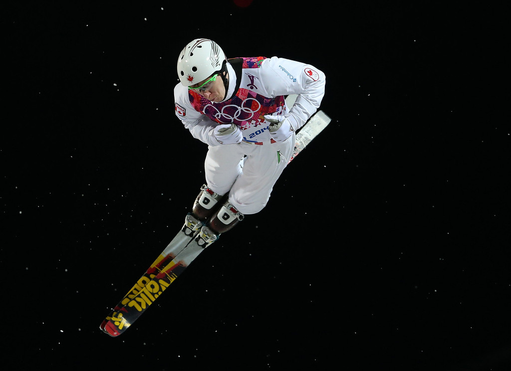 . Canada\'s Travis Gerrits jumps during the men\'s freestyle skiing aerials final at the Rosa Khutor Extreme Park, at the 2014 Winter Olympics, Monday, Feb. 17, 2014, in Krasnaya Polyana, Russia. (AP Photo/Sergei Grits)