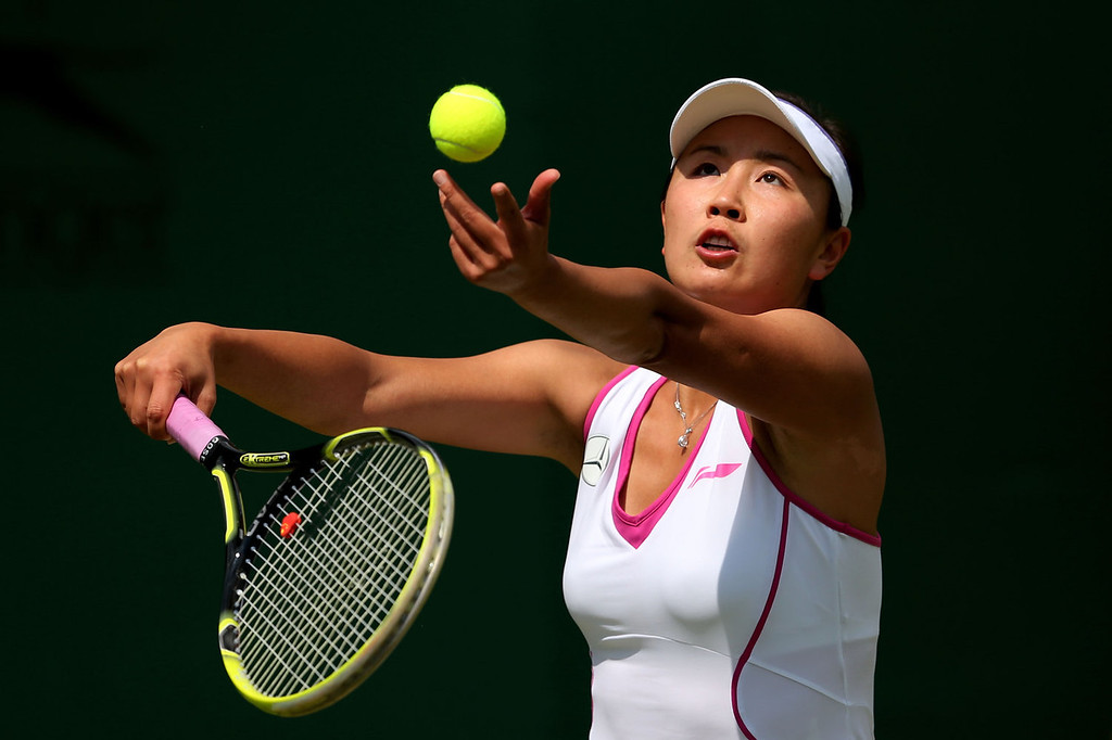 . Shuai Peng of China serves during her Ladies\' Singles first round match against Anabel Medina Garrigues of Spain on day two of the Wimbledon Lawn Tennis Championships at the All England Lawn Tennis and Croquet Club on June 25, 2013 in London, England.  (Photo by Julian Finney/Getty Images)