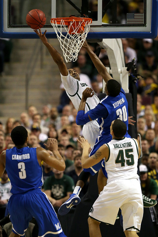 . AUBURN HILLS, MI - MARCH 23:  Keith Appling #11 of the Michigan State Spartans drives for a shot attempt against D.J. Stephens #30 of the Memphis Tigers during the third round of the 2013 NCAA Men\'s Basketball Tournament at The Palace of Auburn Hills on March 23, 2013 in Auburn Hills, Michigan.  (Photo by Jonathan Daniel/Getty Images)
