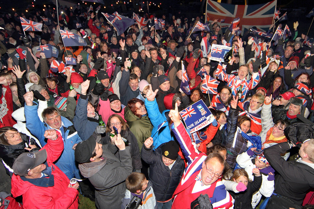 . Islanders celebrate after the annouce of the referendum\'s result in Port Stanley, Falkland (Malvinas for Argentina) Islands, on March 11, 2013. Falkland Islanders were to vote  on the final day of a two-day referendum designed to make clear their staunch desire to remain British despite Argentina\'s sovereignty claims. Only three votes out of 1,517 were cast against the islands remaining British. TONY CHATER/AFP/Getty Images