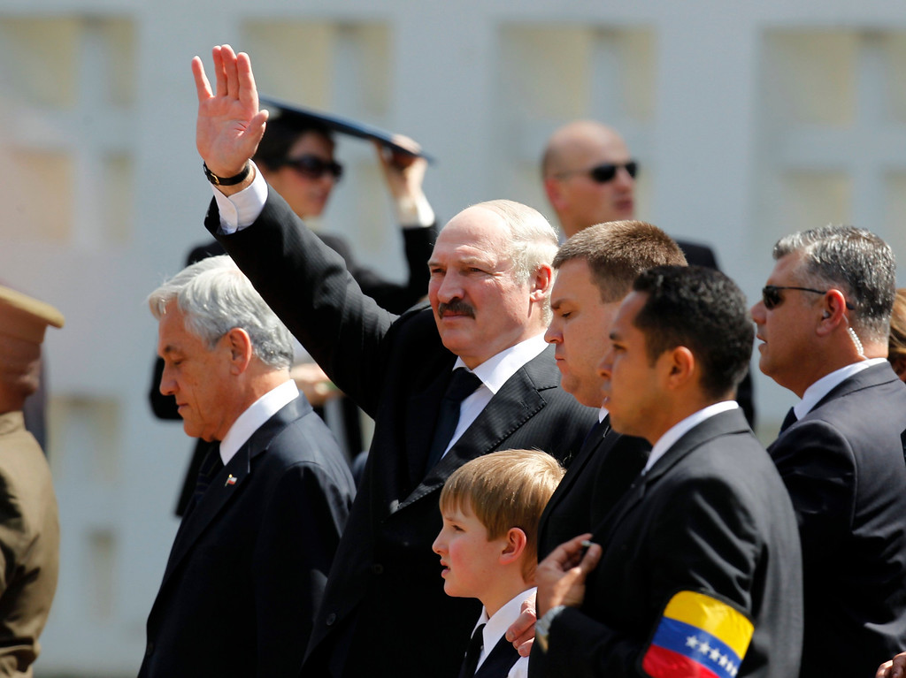 . Belarus President Alexander Lukashenko (2nd L), his son Nikolay (3rd L) and Chile\'s President Sebastian Pinera (L) leave the funeral ceremony for Venezuela\'s late President Hugo Chavez, at the Military Academy in Caracas, March 8, 2013.  REUTERS/Jorge Dan Lopez