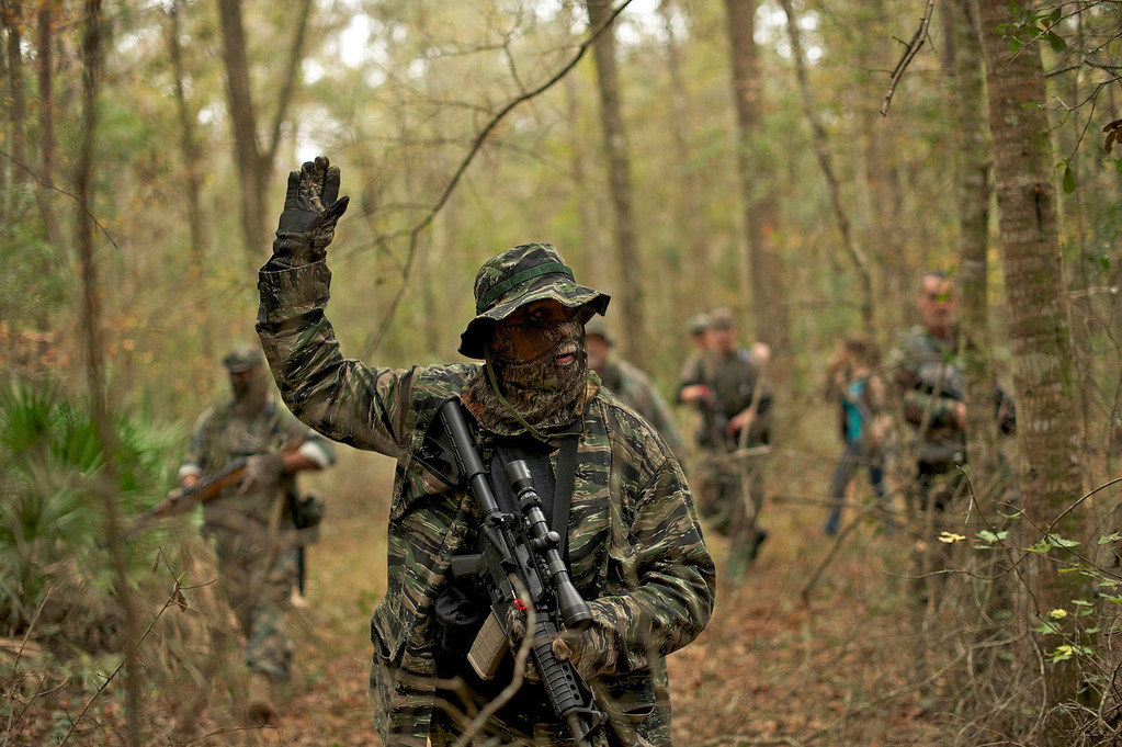 . A member of the North Florida Survival Group carries an AR-15 rifle as he takes the point position in performing enemy contact drills during a field training exercise in Old Town, Florida, December 8, 2012.REUTERS/Brian Blanco