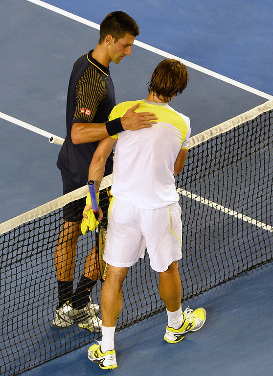 . Serbia\'s Novak Djokovic (L) shakes hands with Spain\'s David Ferrer after his victory during their men\'s singles semi-final match on day 11 of the Australian Open tennis tournament in Melbourne on January 24, 2013.  WILLIAM WEST/AFP/Getty Images