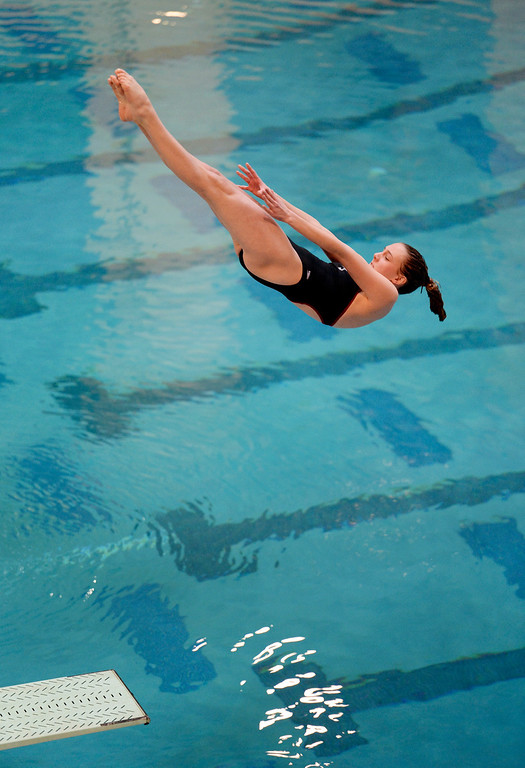 . THORNTON, CO. - FEBRUARY 15, 2014: Regis Jesuit High School sophomore Mckensi Austin performed her first of three dives during competition Saturday. The CHSAA 5A Girl\'s State Swimming Championships wrapped up Saturday night February 14, 2104.  Photo By Karl Gehring/The Denver Post