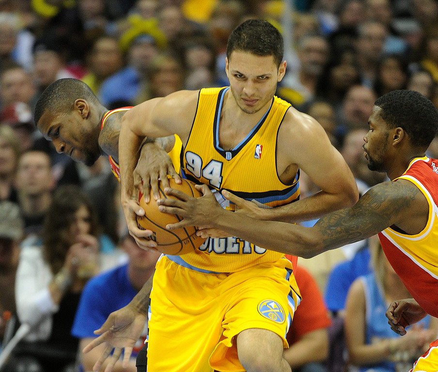 . DENVER, CO. - APRIL 6: Evan Fournier (94) of the Denver Nuggets tried to secure the ball in the second half. The Denver Nuggets defeated the Houston Rockets 132-114 at the Pepsi Center Saturday night, April 6, 2013. Photo By Karl Gehring/The Denver Post)