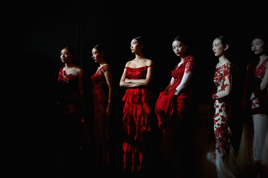 . Models prepare backstage ahead of Peng Jing Wedding Dress Collection show during Mercedes-Benz China Fashion Week Spring/Summer 2014 at 751 D-PARK Central Hall on October 27, 2013 in Beijing, China.  (Photo by Feng Li/Getty Images)