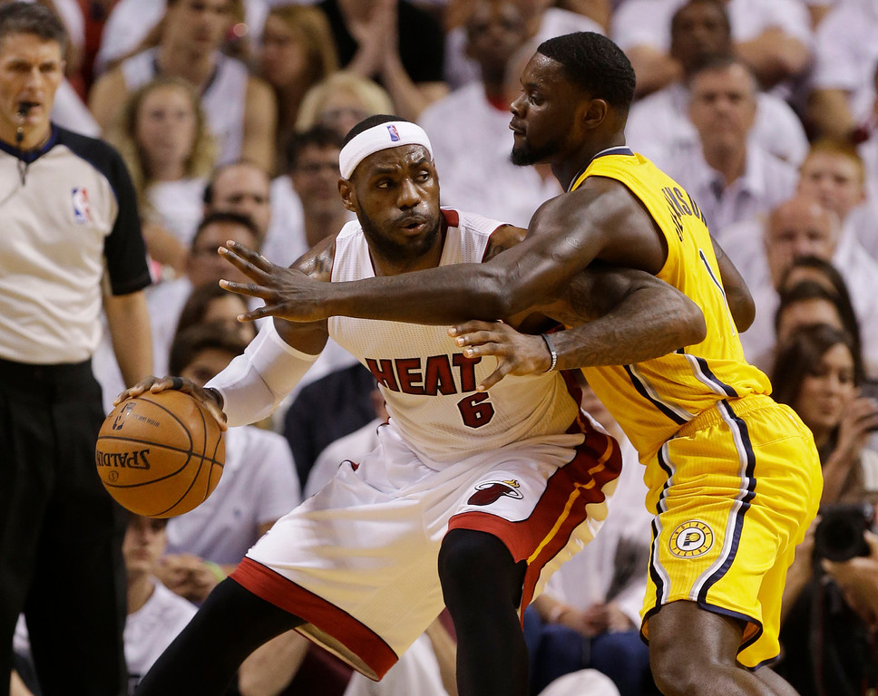 . Indiana Pacers guard Lance Stephenson (1) defends Miami Heat forward LeBron James (6) during the first half Game 6 in the NBA basketball playoffs Eastern Conference finals on Friday, May 30, 2014, in Miami. (AP Photo/Lynne Sladky)
