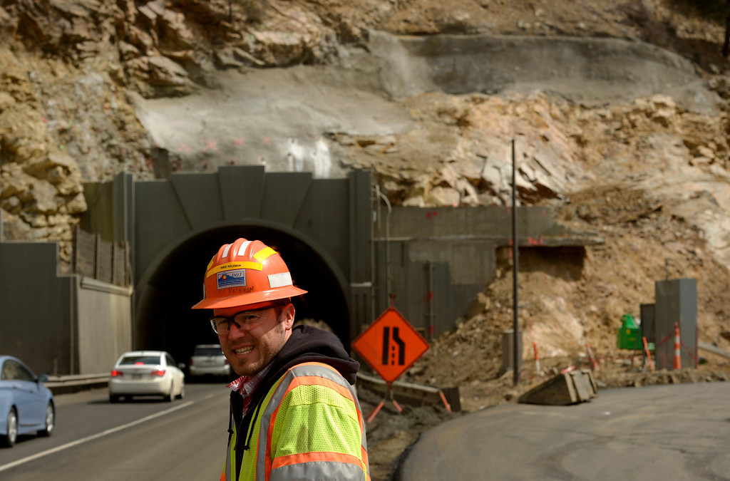 . IDAHO SPRINGS, CO- MARCH 28:  Mike Keleman, a project engineer with CDOT, checks the flow of traffic on the project site.  Behind him, to the right,  is where crews will be blasting out rock on the right to increase the size of the east bound tunnel.  Construction continues on road work on I-70 and the twin tunnels near Idaho Springs on March 28th, 2013.  The highway is being widened in the east bound lanes.  The widening will start just west of the twin tunnels after Idaho Springs and will continue until the exit for Highway 6 where I-70 becomes three lanes.  They expect the project to be finished by the end of 2013.  (Photo By Helen H. Richardson/ The Denver Post)