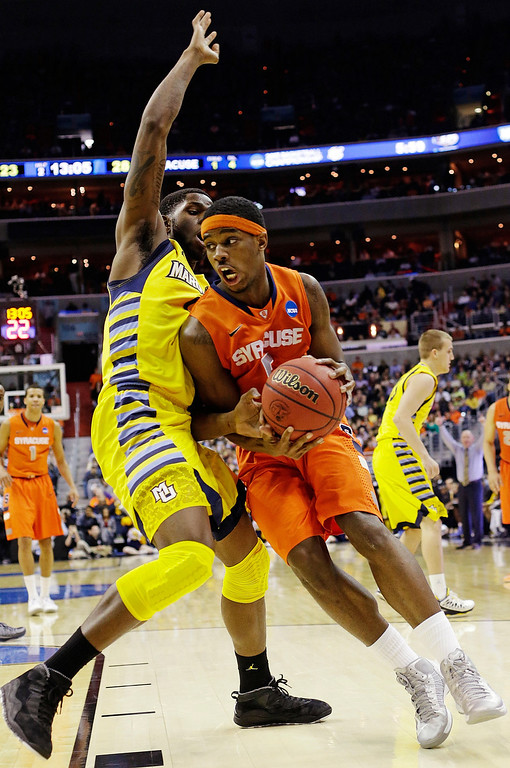 . Syracuse forward C.J. Fair (5) drives past Marquette forward Jamil Wilson (0) during the second half of the East Regional final in the NCAA men\'s college basketball tournament, Saturday, March 30, 2013, in Washington. (AP Photo/Pablo Martinez Monsivais)