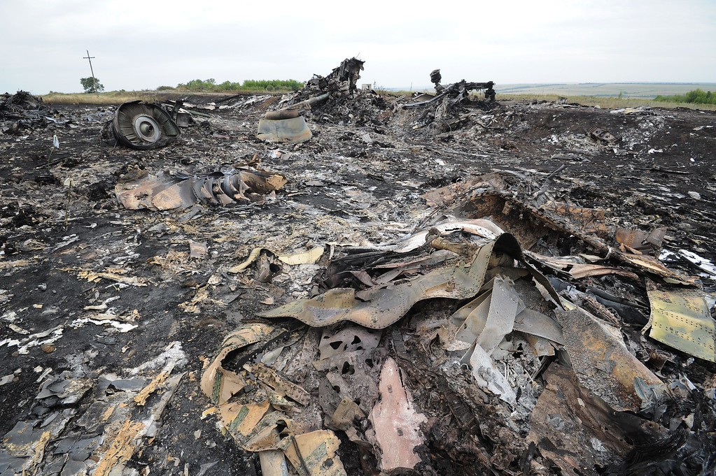 . A picture taken on July 18, 2014 shows the wreckages of the Malaysia Airlines jet carrying 298 people from Amsterdam to Kuala Lumpur a day after it crashed, near the town of Shaktarsk, in rebel-held east Ukraine. Pro-Russian separatists in the region and officials in Kiev blamed each other for the crash, after the plane was apparently hit by a surface-to-air missile. AFP PHOTO/DOMINIQUE  FAGET/AFP/Getty Images