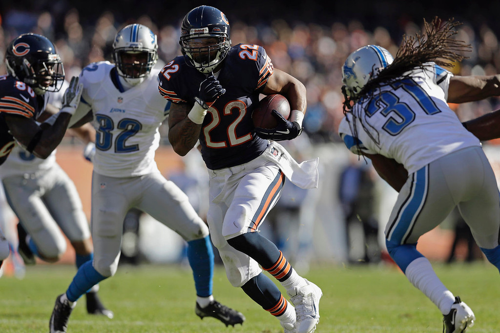 . Chicago Bears running back Matt Forte (22) rushes past Detroit Lions cornerback Rashean Mathis (31) during the first half of an NFL football game, Sunday, Nov. 10, 2013, in Chicago. (AP Photo/Nam Y. Huh)