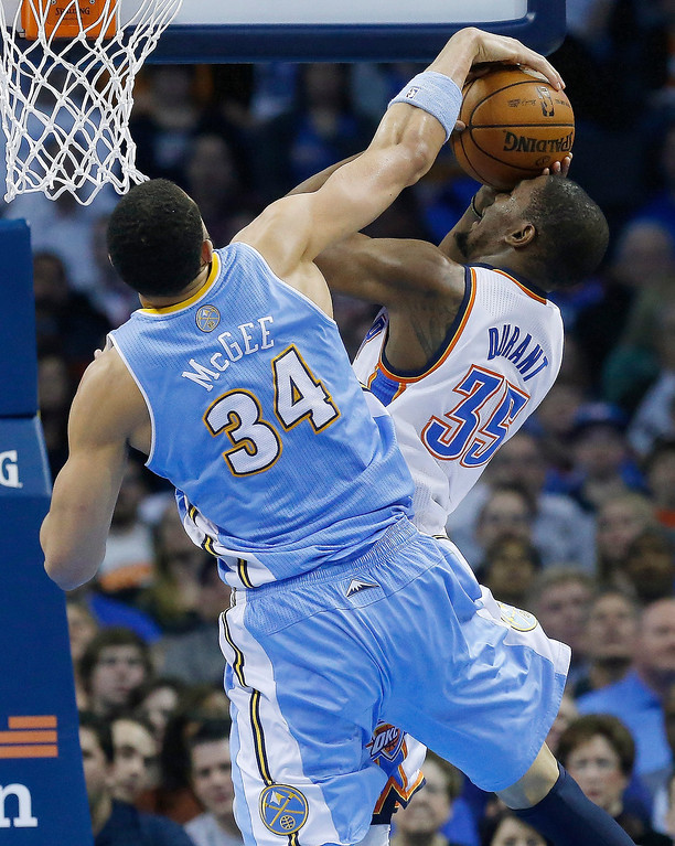 . Denver Nuggets center JaVale McGee (34) blocks a shot by Oklahoma City Thunder forward Kevin Durant (35) in the second quarter of an NBA basketball game in Oklahoma City, Tuesday, March 19, 2013. Denver won 114-104. (AP Photo/Sue Ogrocki)