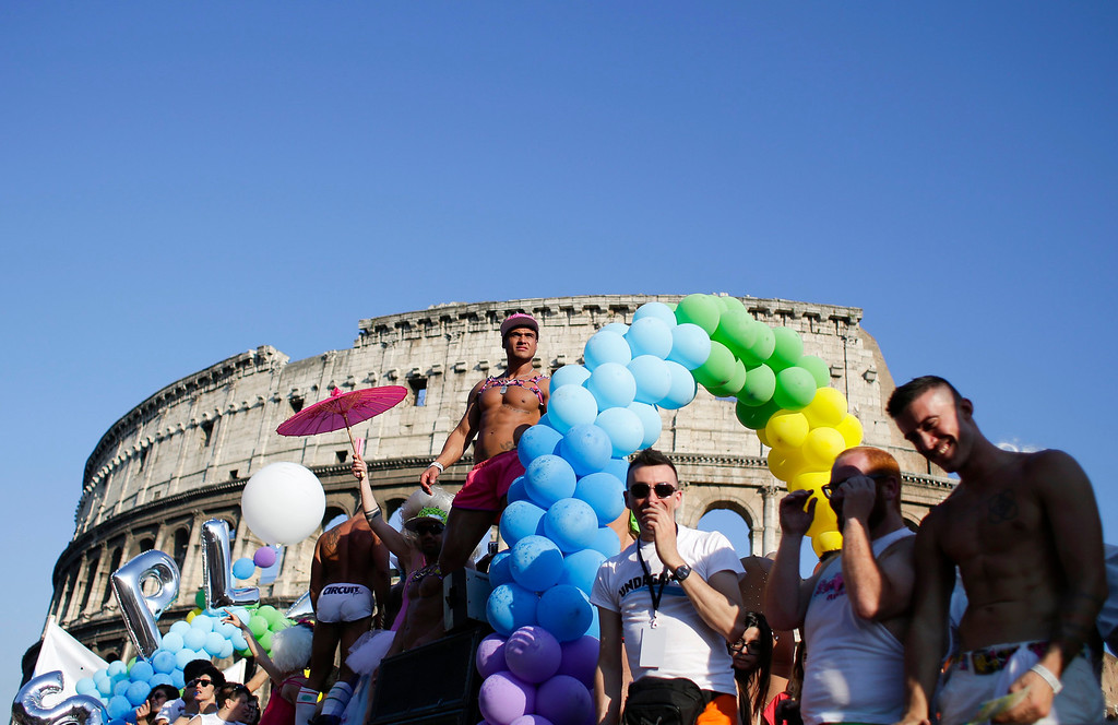 . A dancer performs in front of the Colosseum during the annual gay pride parade in downtown Rome June 15, 2013. REUTERS/Max Rossi