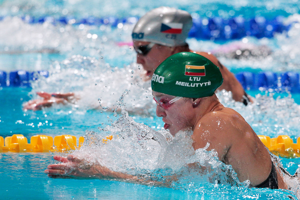 . BARCELONA, SPAIN - AUGUST 03:  Ruta Meilutyte of Lithuania sets a new World Record time of 29.48 in the Swimming Women\'s Breaststroke 50m Semifinal heat 2 on day fifteen of the 15th FINA World Championships at Palau Sant Jordi on August 3, 2013 in Barcelona, Spain.  (Photo by Adam Pretty/Getty Images)