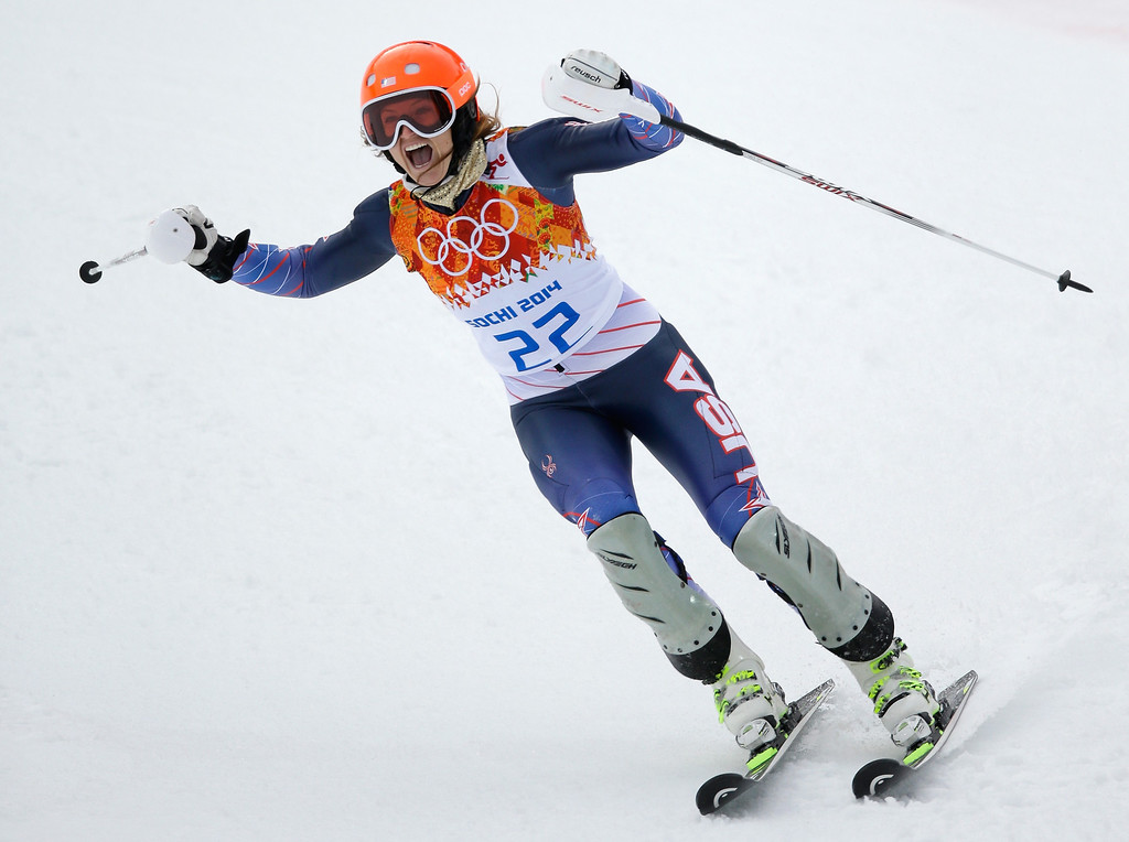 . Julia Mancuso of the United States celebrates during the Alpine Skiing Women\'s Super Combined Slalom on day 3 of the Sochi 2014 Winter Olympics at Rosa Khutor Alpine Center on February 10, 2014 in Sochi, Russia.  (Photo by Ezra Shaw/Getty Images)